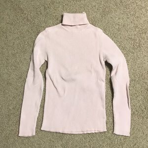 Pale pink ribbed long sleeve turtleneck sweater